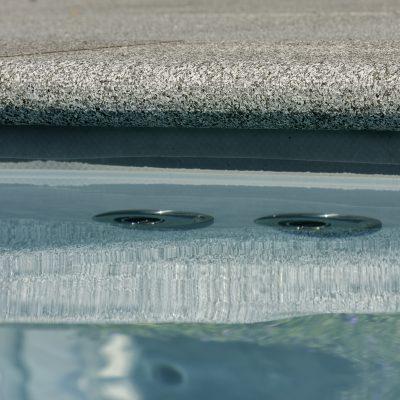 Zwembad randstenen aanleggen